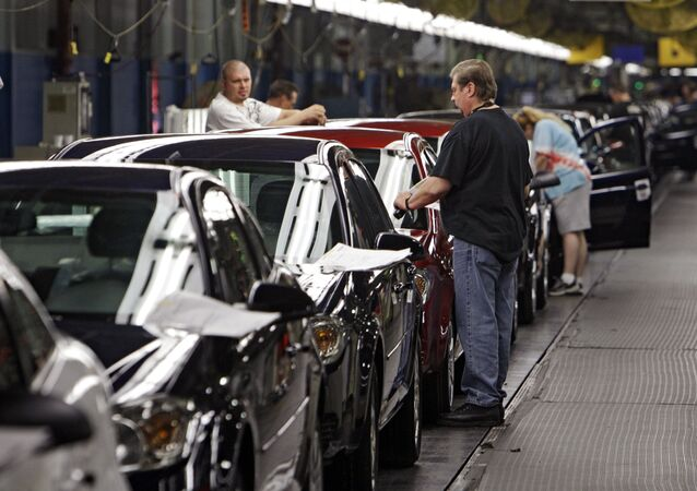 In this Tuesday, June 15, 2010, file photo, workers at General Motors' Lordstown Assembly plant in Lordstown, Ohio put the final touches on Chevy Cobalts