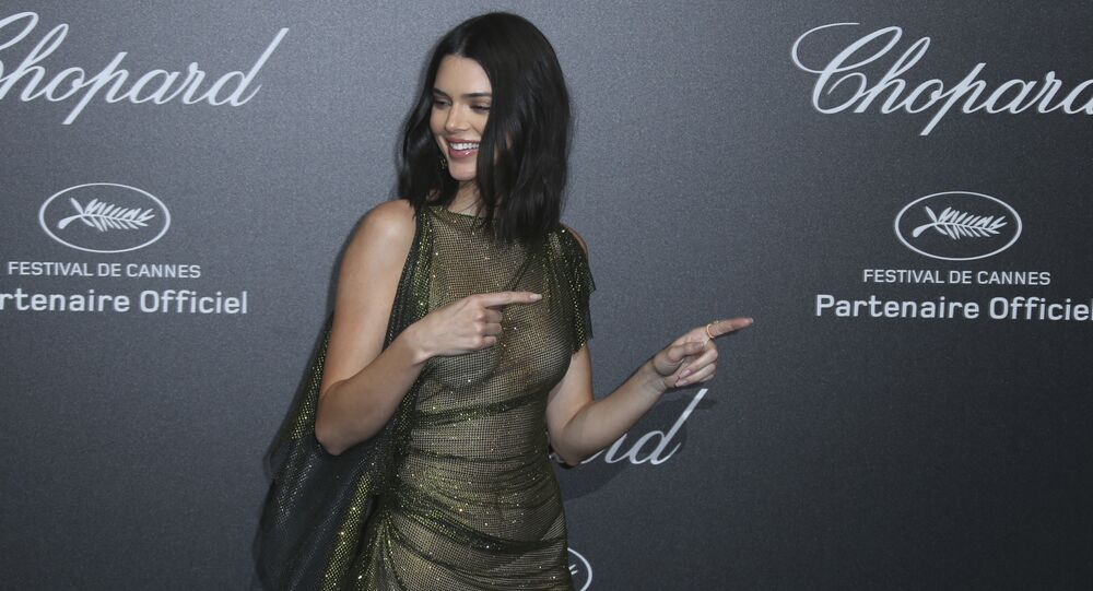 Model Kendall Jenner poses for photographers upon arrival at the Chopard Secret party during the 71st international film festival, Cannes, southern France, Friday, May 11, 201