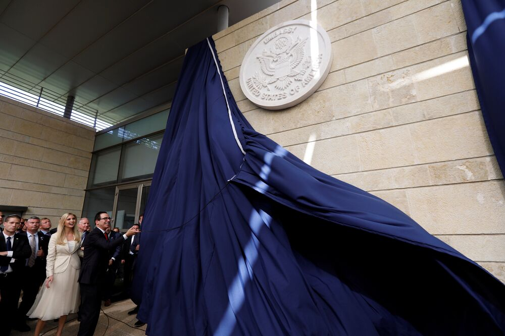 U.S. Treasury Secretary Steven Mnuchin unveils the seal for the new U.S. embassy, as he stands next to Senior White House Adviser Ivanka Trump during the dedication ceremony of the new U.S. embassy in Jerusalem, May 14, 2018