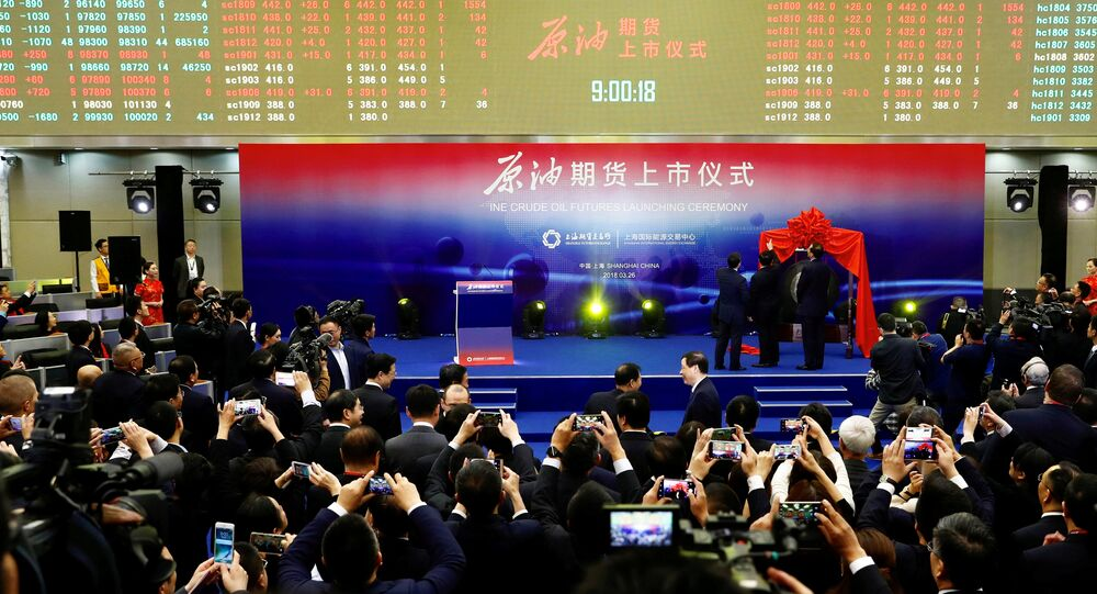 People attend the launch ceremony of Shanghai crude oil futures at the Shanghai International Energy Exchange (INE) in Shanghai, China March 26, 2018