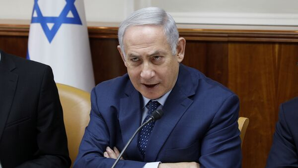 Israeli Prime Minister Benjamin Netanyahu chairs the weekly cabinet meeting at the Prime Minister's office in Jerusalem, Sunday, April 15, 2018 - Sputnik International
