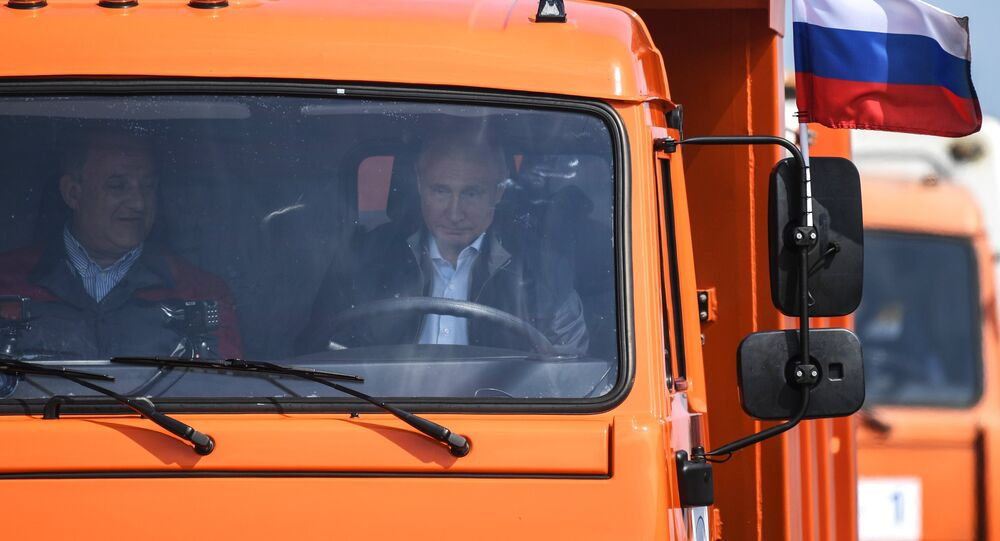 Russian President Vladimir Putin drives a Kamaz truck on the newly opened motor road section of the Kerch Strait (Crimean) Bridge