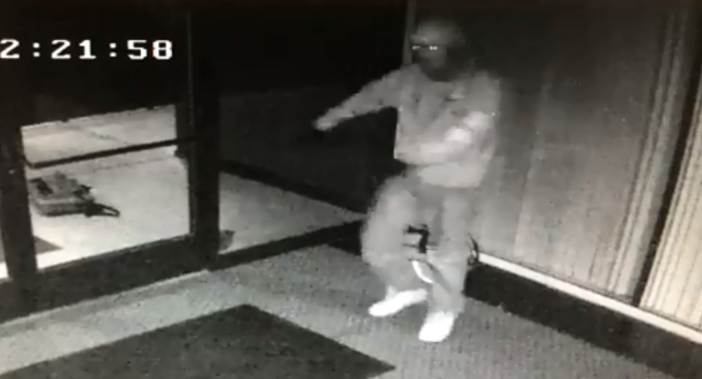 Fresno Police Department release footage showing robber go into a celebratory dance after entering an office building with set of copied keys.
