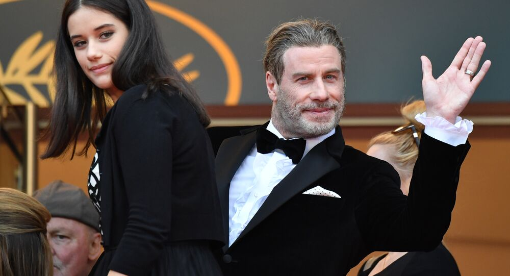 US actor John Travolta (R) and his daughter Ella Bleu Travolta arrive on May 15, 2018 for the screening of the film Solo : A Star Wars Story at the 71st edition of the Cannes Film Festival in Cannes, southern France