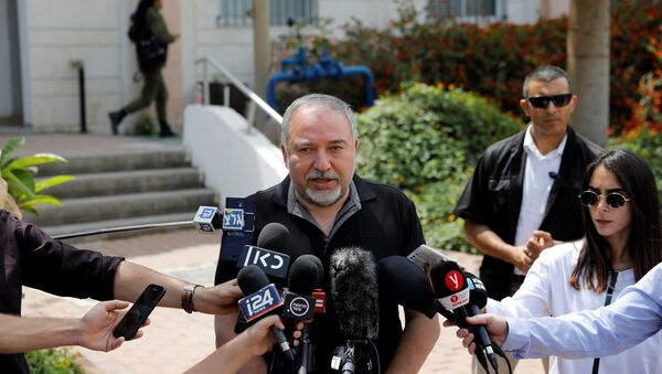 Israeli Defence Minister Avigdor Lieberman speaks after attending a meeting at an Israeli military base near Kissufim on the Israeli side of the border between Israel and the Gaza Strip, May 16, 2018 - Sputnik International