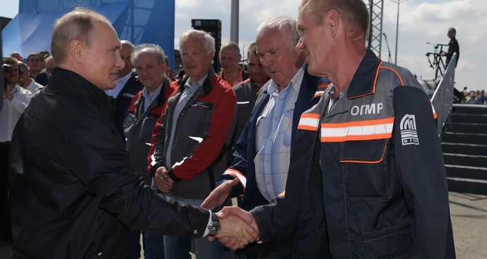 May 15, 2018. Russian President Vladimir Putin talks to builders after speaking at a concert and rally to mark the opening of the motor road section of the Kerch Strait (Crimean) Bridge