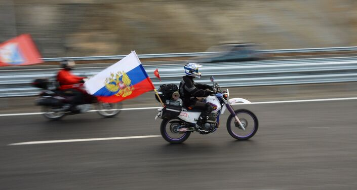 Motorcyclists on the Crimean Bridge's freeway section