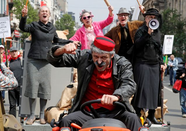 Belgian workers and employees take part in a protest against planned pension reforms in central Brussels, Belgium May 16, 2018