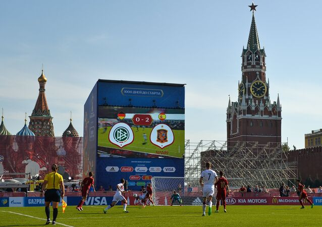Players of the Spanish and German teams during a football match on Red Square marking 1000 days before 2018 World Cup in Russia.