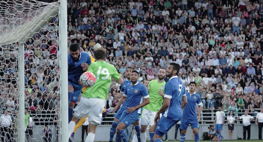 Abkhazia (in the green) taking on Panjab in the 2016 Conifa World Cup final