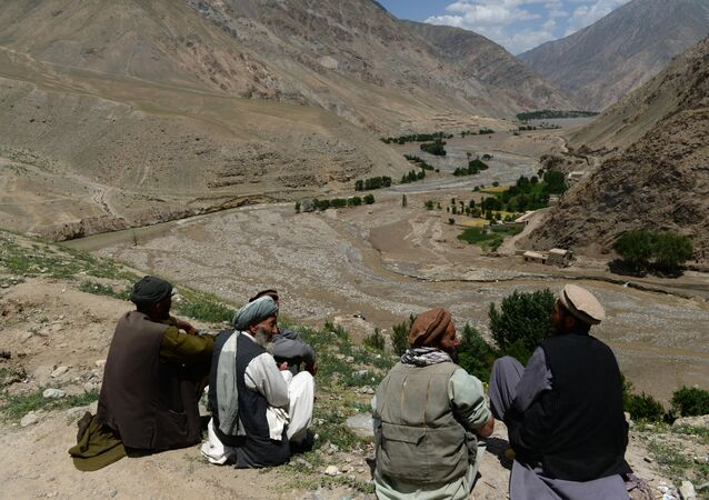 Afghan villagers sit on hilltop in the Guzargah-e-Nur district of Baghlan province (File)