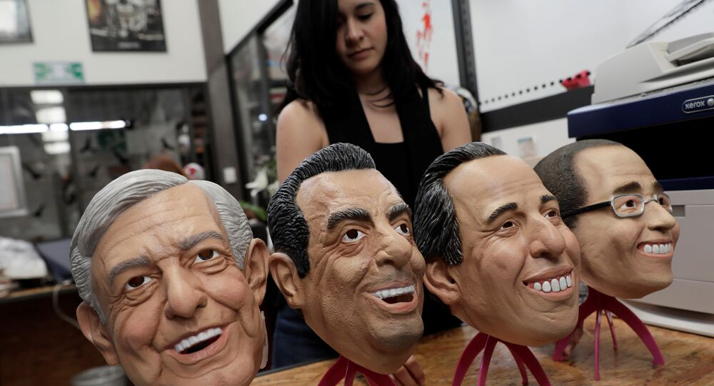 An employee moves masks of Leftist front-runner Andres Manuel Lopez Obrador of (MORENA), Ricardo Anaya, presidential candidate for the National Action Party (PAN), Institutional Revolutionary Party (PRI) presidential candidate Jose Antonio Meade and Independent presidential candidate Jaime Rodriguez are seen at a factory where the latex masks, in Cuernavaca, Mexico May 15, 2018