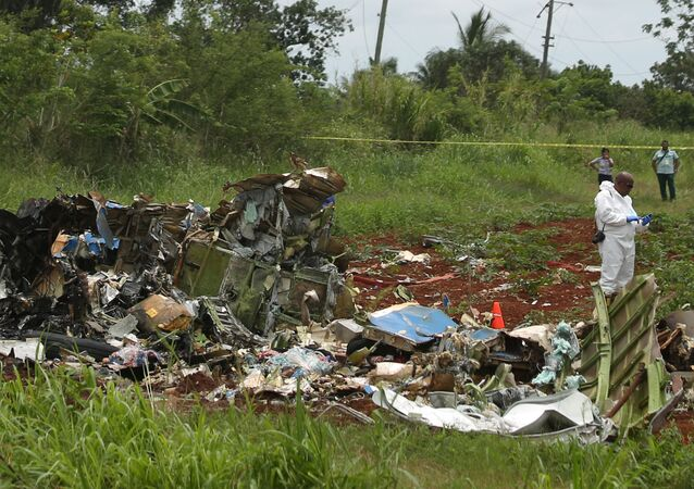 A rescue team member works at the wreckage of a Boeing 737 plane that crashed in the agricultural area of Boyeros, around 20 km (12 miles) south of Havana, shortly after taking off from Havana's main airport in Cuba, May 18, 2018.