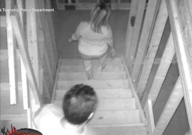 A man and woman are accused of repeatedly trespassing in a luxury house that is under construction to take a poop