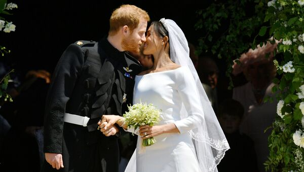 Prince Harry and Meghan Markle kiss on the steps of St George's Chapel in Windsor Castle after their wedding in Windsor, Britain, May 19, 2018 - Sputnik International