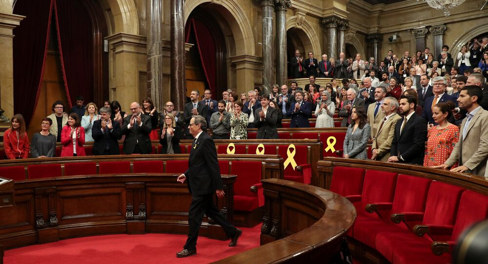 Newly elected Catalonia regional president, Quim Torra, is applauded by pro-indpendence parties following an investiture debate at the regional parliament in Barcelona, Spain, May 14, 2018