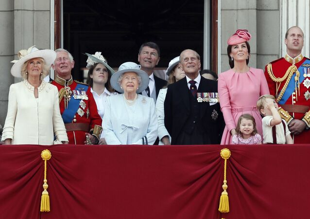 Members of Britain's Royal family from left, Camilla, the Duchess of Cornwall, Prince Charles, Princess Eugenie, Queen Elizabeth II, background Timothy Laurence, Princess Beatrice, Prince Philip, Kate, the Duchess of Cambridge, Princess Charlotte, Prince George and Prince William watch a fly past as they appear on the balcony of Buckingham Palace, after attending the annual Trooping the Colour Ceremony in London, Saturday, June 17, 2017
