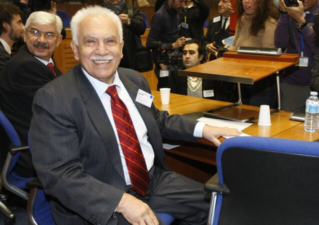 Turkish citizen, Dogu Perincek, poses for photographers prior to the start oh his hearing before the European Court of Human rights in Strasbourg, eastern France, Wednesday, Jan. 28, 2015