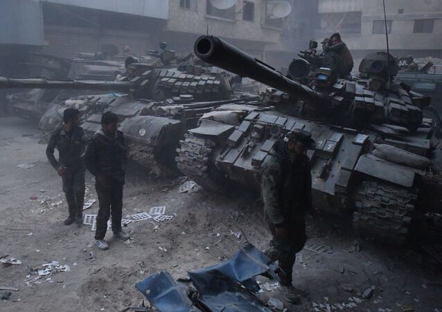 The Syrian Army's tanks in the area of the former Palestinian refugee camp Yarmouk in the southern suburb of Damascus