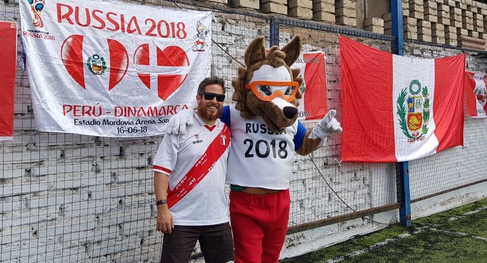 Enrique de la Lama with the 2018 World Cup mascot Zabivaka