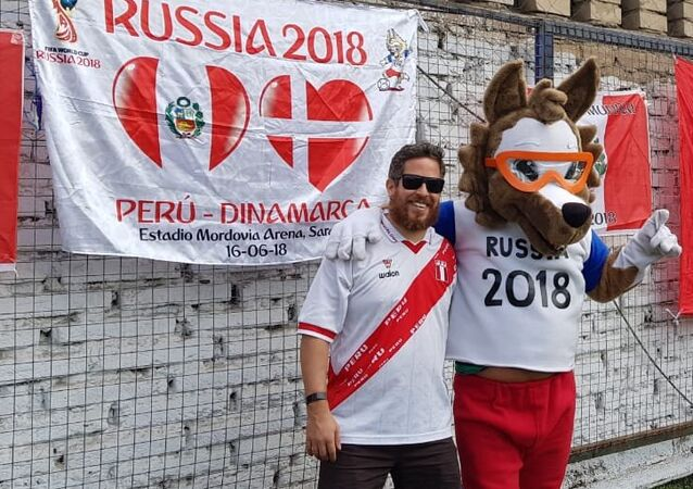 Enrique de la Lama with the 2018 World Cup mascot Zabivaka