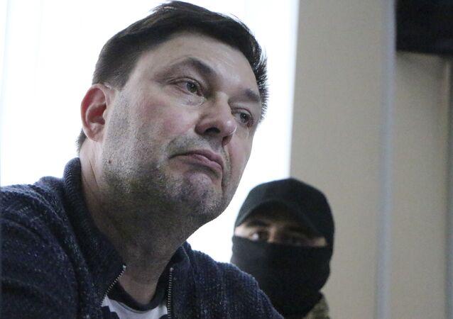 Kirill Vyshinskiy, bureau chief of RIA Novosti news agency in Ukraine, listens to lawyer in a court room in Kherson, Ukraine, Thursday, May 17, 2018