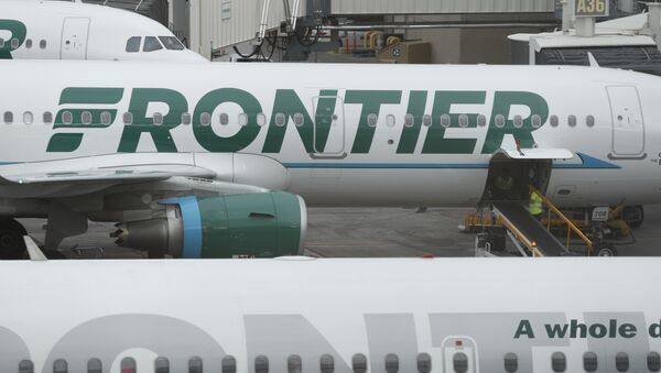 In this Monday, May 15, 2017, photograph, the company logo is showcased on the side of a Frontier Airlines airplane waiting at a gate on Concourse A in Denver International Airport in Denver - Sputnik International