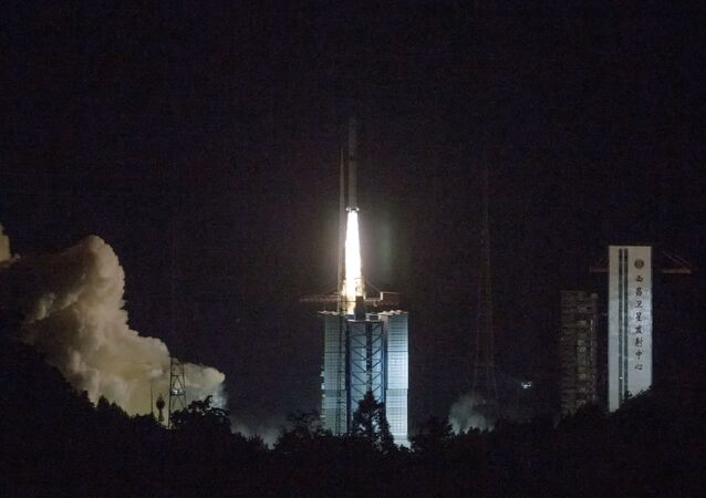 In this photo provided by China's official Xinhua News Agency, a Long March-4C rocket carrying a relay satellite, named Queqiao (Magpie Bridge), is launched from southwest China's Xichang Satellite Launch Center, Monday, May 21, 2018. China has launched a relay satellite as part of a groundbreaking program to land a probe on the far side of the moon this year. The China National Space Administration said on its website that the satellite lofted into space early Monday aboard a Long March-4C rocket will facilitate communication between controllers on Earth and the Chang'e 4 mission.