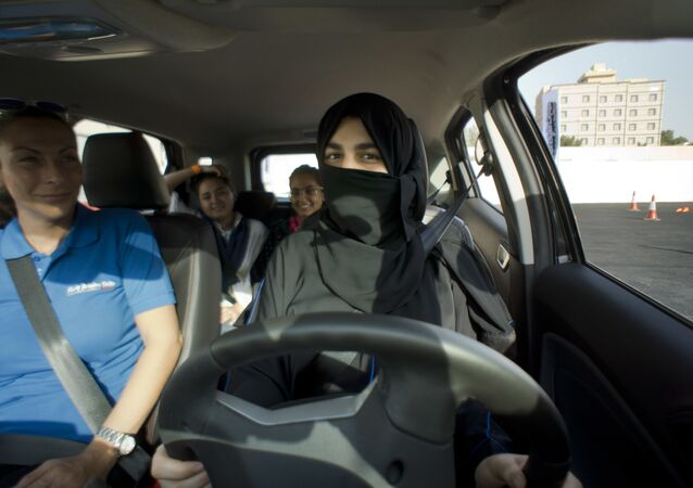 Razan, right, sits for the first time in the driver's seat, with her trainer Francesca Pardini, an Italian ex-race car driver, during training sponsored by Ford Motor, in Jiddah, Saudi Arabia, Tuesday, March 6, 2018. A stunning royal decree issued last year by King Salman announcing that women would be allowed to drive in 2018 upended one of the most visible forms of discrimination against women in Saudi Arabia.