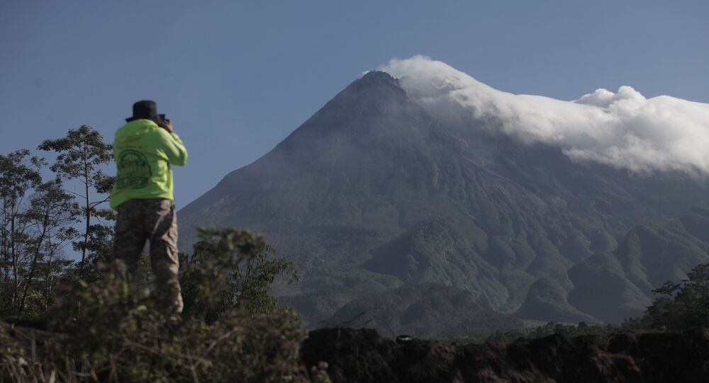 An officer monitors the activity of Mount Merapi volcano after its alert level was increased following a series of minor eruptions in Cangkringan, Sleman, Yogyakarta, Indonesia May 22, 2018 in this photo taken by Antara Foto
