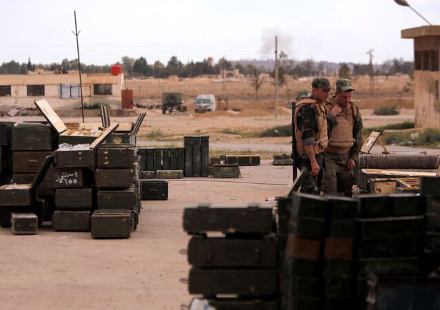 Russian soldiers stand next to boxes of ammunition and weapons, that belonged to rebels from Eastern Qalamoun, after they handed them over, at the town of Dumayr, Damascus, Syria, April 22, 2018