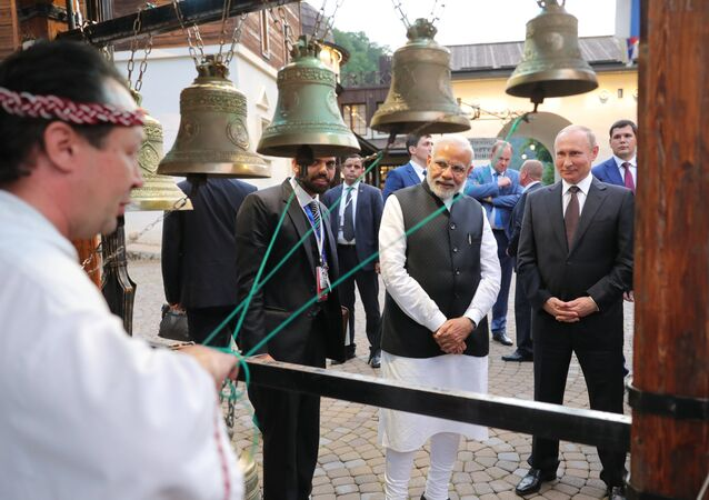 Russian President Vladimir Putin and Indian Prime Minister Narendra Modi during a visit to the My Russia culture & ethnography center