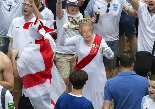 An England supporter wearing a mask and dressed as Queen Elizabeth II dances on Jean-Jaures square in Saint-Etienne on June 20, 2016, before the Euro 2016 group B football match between Slovakia and England.