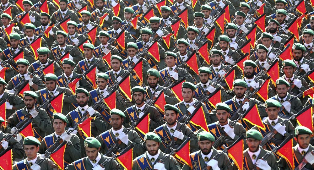 In this Sept. 21, 2016 file photo, Iran's Revolutionary Guard troops march in a military parade marking the 36th anniversary of Iraq's 1980 invasion of Iran, in front of the shrine of late revolutionary founder Ayatollah Khomeini, just outside Tehran, Iran