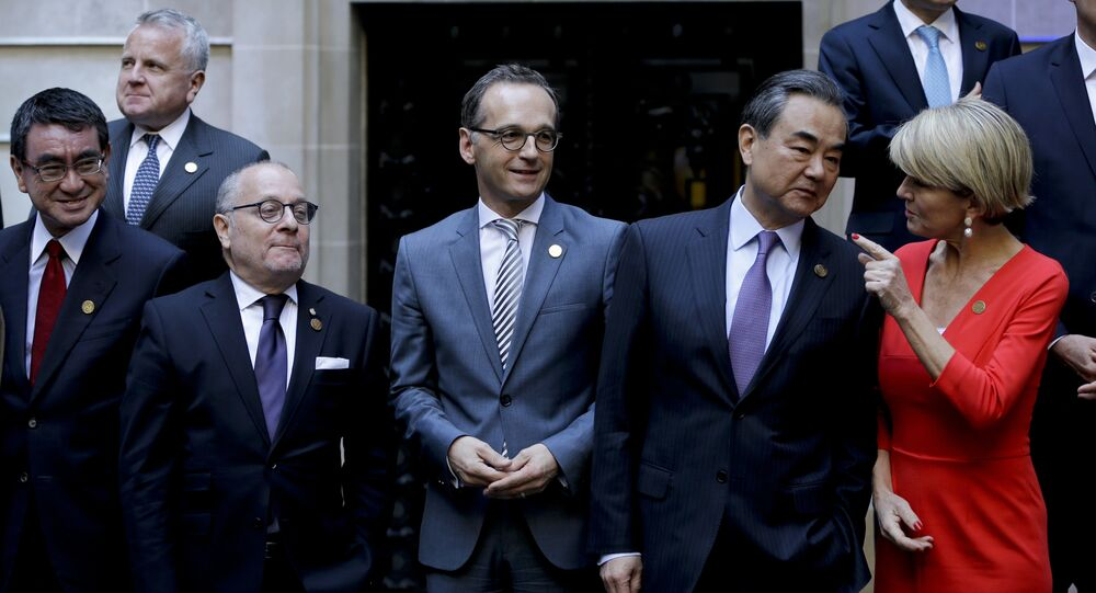 Argentina's Foreign Secretary Jorge Faurie, second from left, Germany's Foreign Minister Heiko Maas, third from left, China's Foreign Minister Wang Yi, second from right, and Australia's Foreign Affairs Minister Julie Bishop talk before the group picture during the G20 foreign ministers meeting at San Martin Palace in Buenos Aires, Argentina, Monday, May 21, 2018