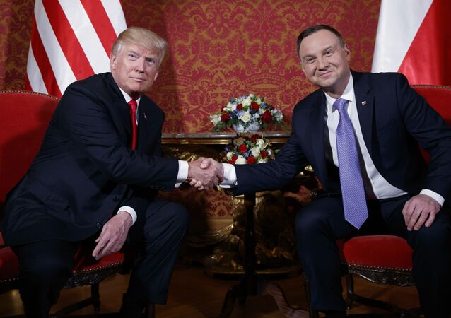 U.S. President Donald Trump, left, and Polish President Andrzej Duda pose for photographers as they shake hands during their meeting at the Royal Castle, Thursday, July 6, 2017, in Warsaw