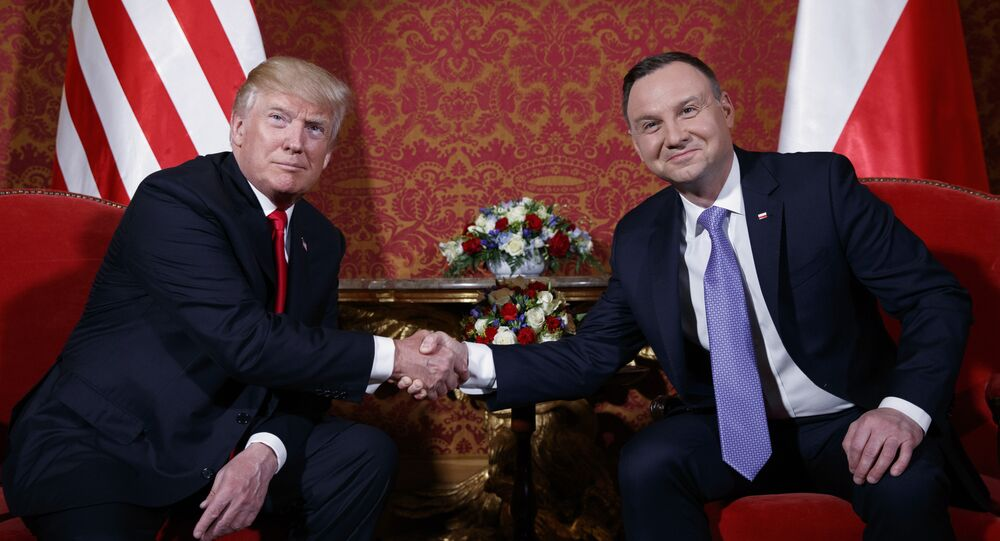 US President Donald Trump, left, and Polish President Andrzej Duda pose for photographers as they shake hands during their meeting at the Royal Castle, Thursday, July 6, 2017, in Warsaw