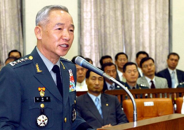 (File) This picture taken 07 July 2004 shows South Korea's army chief general Nam Jae-Joon (L) speaking during a national assembly committee in Seou