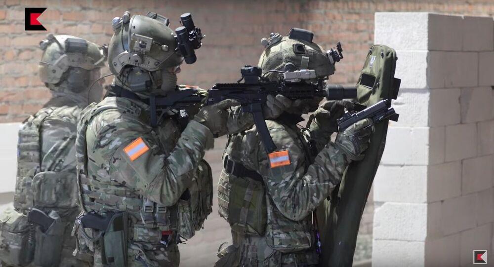 Kalashnikov Concern experts showing Vityaz submachine gun capabilities