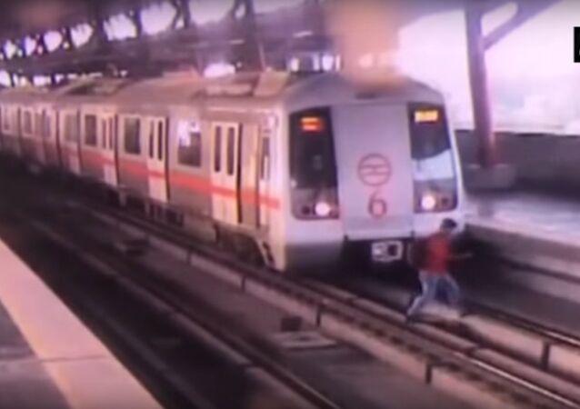 Watch video: Man crosses tracks at Delhi Metro station as train starts moving