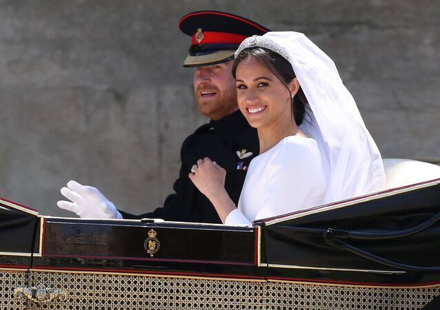 Meghan Markle and Prince Harry ride in an Ascot Landau carriage at Windsor Castle after their wedding in Windsor, Britain, May 19, 2018
