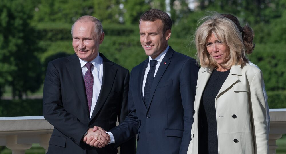 Russian President Vladimir Putin with French President Emmanuel Macron and his wife Brigitte Macron during a meeting in St. Petersburg, Russia May 24, 2018