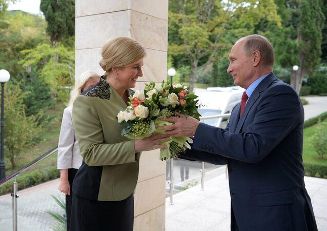President Putin giving Croatian President Kolinda Grabar-Kitarovic a bouquet during her visit to Russia, October 2017.