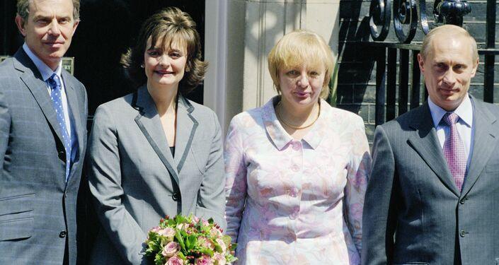 Vladimir Putin, his wife Lyudmila, Tony Blair and his wife Cherie.