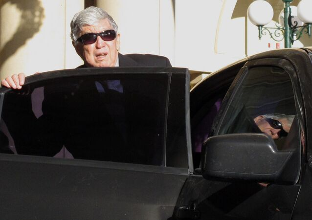In this April 7, 2011 photo, Luis Posada Carriles gets into a car in front of the Camino Real hotel in downtown EL Paso, Texas