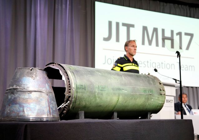 A damaged missile is displayed during a news conference by members of the Joint Investigation Team, comprising the authorities from Australia, Belgium, Malaysia, the Netherlands and Ukraine who present interim results in the ongoing investigation of the 2014 MH17 crash that killed 298 people over eastern Ukraine, in Bunnik, Netherlands, May 24, 2018