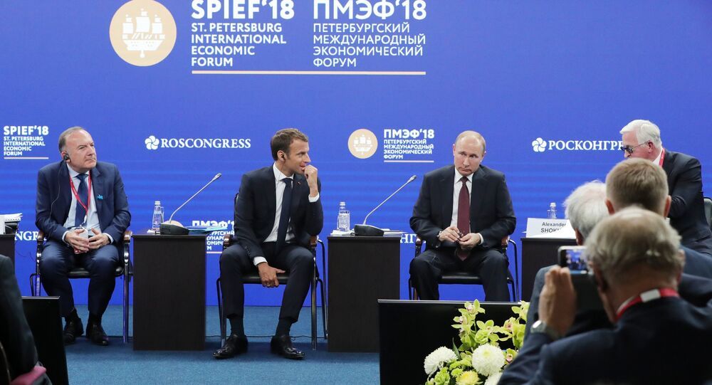President of Russia Vladimir Putin and President of France Emmanuel Macron, second, left, during Russia-France Business Dialogue held as part of the St. Petersburg International Economic Forum. Left: President of the Movement of the Enterprises of France (MEDEF) Pierre Gattaz.