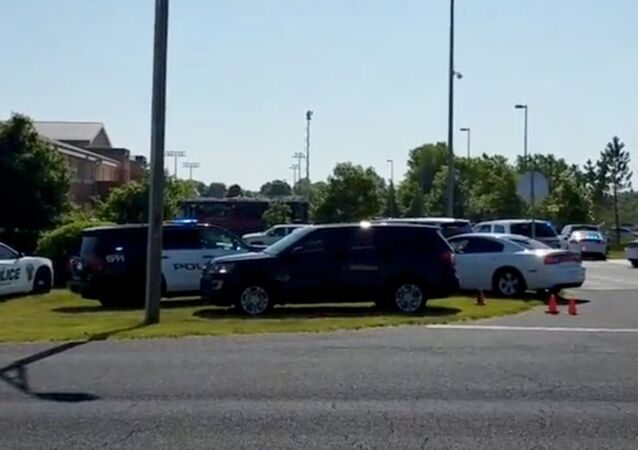 Police is seen near Noblesville West Middle School in Noblesville, Indiana, U.S., May 25, 2018 in this still image obtained from social media video