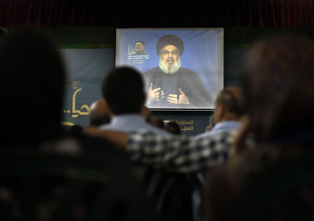 Hezbollah leader Sheik Hassan Nasrallah speaks on a screen via a video link during a ceremony to mark the second anniversary of the death of Hezbollah top commander, Mustafa Badreddine, who was killed in an explosion in Damascus, in the southern suburbs of Beirut, Lebanon, Monday, May 14, 2018