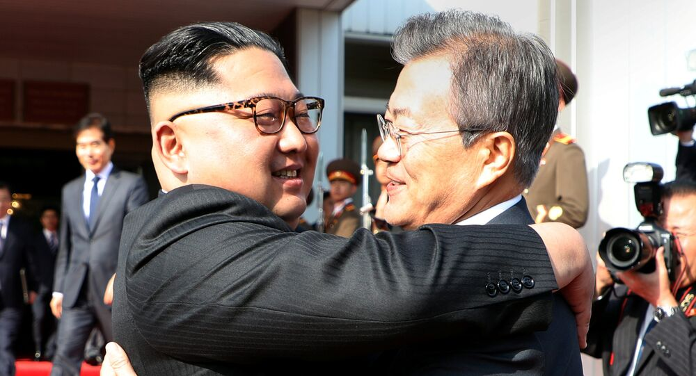 South Korean President Moon Jae-in bids fairwell to North Korean leader Kim Jong Un as he leaves after their summit at the truce village of Panmunjom, North Korea, in this handout picture provided by the Presidential Blue House on May 26, 2018